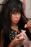 Unhappy Woman. Unhappy black-haired woman with broken doll weeps Royalty Free Stock Image