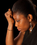 Unhappy woman. Crying young African Ghanese woman against a black background Stock Photos