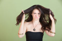 Unhappy Woman with bad Hair Royalty Free Stock Image