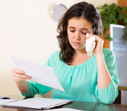 Unhappy woman calculating home Royalty Free Stock Photo