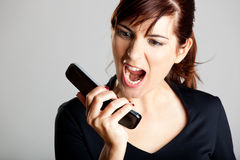 Unhappy woman at cellphone Stock Photo