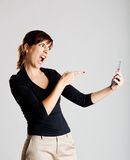 Unhappy woman at cellphone Stock Images