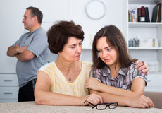 Unhappy woman chatting with sadly daughter Stock Image