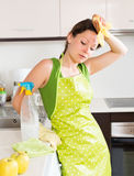 Unhappy woman cleaning furniture Stock Photography
