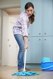 Unhappy Woman Cleaning Kitchen Floor With Mop Stock Photos