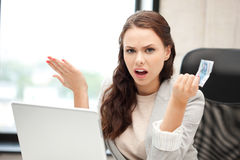 Unhappy woman with computer and euro cash money Royalty Free Stock Photography