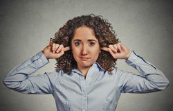 Unhappy woman covering closed ears ignoring you Stock Photo