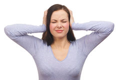 Unhappy woman covering her ears Royalty Free Stock Images