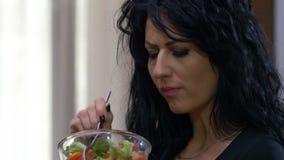 Unhappy woman dislike eating vegetarian healthy food. Attractive unhappy woman dislike eating vegetarian healthy food stock footage