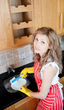 Unhappy woman doing the dishes Royalty Free Stock Images