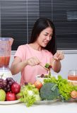 Unhappy woman eating salad in kitchen royalty free stock photo