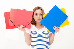 Unhappy woman with folders Stock Images