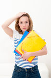 Unhappy woman with folders Royalty Free Stock Image