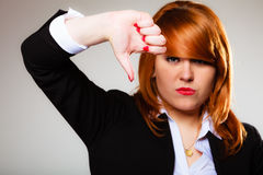 Unhappy woman giving thumb down gesture Stock Images