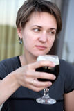 Unhappy woman with glass of beer Stock Image