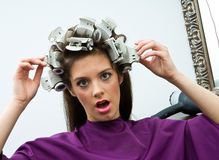 Unhappy woman in hair salon Stock Image