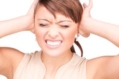 Unhappy woman with hands on ears Stock Photos