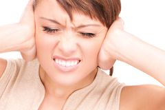 Unhappy woman with hands on ears Stock Photo