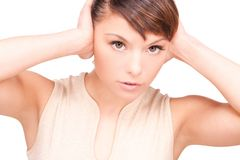 Unhappy woman with hands on ears Royalty Free Stock Image