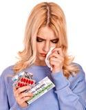 Unhappy woman having flu takes pills. Isolated Royalty Free Stock Photos