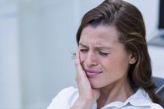 Unhappy woman having a toothache Stock Image