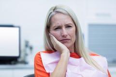 Unhappy woman having a toothache Stock Photo