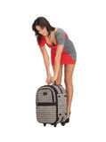 Unhappy woman with heavy suitcase Royalty Free Stock Photo