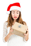 Unhappy woman with her christmas gift Royalty Free Stock Image