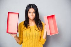 Unhappy woman holding empty gift box Stock Photos