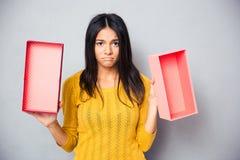 Unhappy woman holding empty gift box Stock Photos