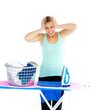Unhappy woman ironing her clothes Royalty Free Stock Photos