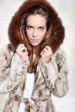 Unhappy woman in luxurious fur coat Stock Photos