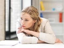 Unhappy woman in office Stock Photography