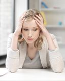 Unhappy woman in office Royalty Free Stock Images