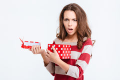 Unhappy woman opening gift box Stock Photo
