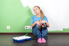Unhappy woman with paint tools. In hands royalty free stock photos