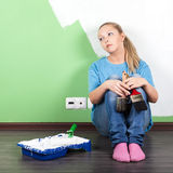 Unhappy woman with paint tools. In hands stock photography