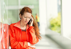 Unhappy woman on a phone Royalty Free Stock Images