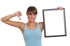 Unhappy woman with picture frame Royalty Free Stock Photos