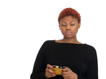 Unhappy woman reading bad news, email text on cellphone. Closeup portrait young serious, unhappy woman seeing bad news, email text on cellphone, smartphone Royalty Free Stock Image