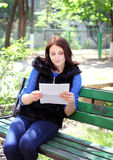 Unhappy woman reads the letter Royalty Free Stock Image