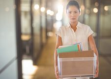 Unhappy Woman redundant with box against office Royalty Free Stock Photo