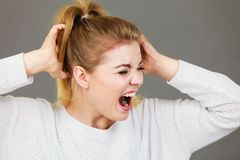 Unhappy woman screaming and yelling in pain Stock Image