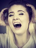 Unhappy woman screaming and yelling in pain Stock Images