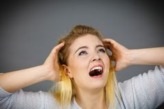 Unhappy woman screaming and yelling in pain. Bad, negative human face expressions, gestures concept Royalty Free Stock Photography