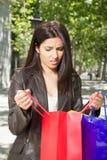 Unhappy woman with shopping bags Stock Photos