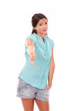 Unhappy woman in short jeans with thumb down Royalty Free Stock Image