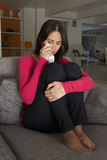 Unhappy Woman Sitting On Sofa Crying Royalty Free Stock Images