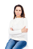 Unhappy woman staring at camera. On white background Stock Photography