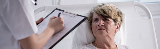 Unhappy woman staying in hospital Stock Photos